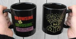 Monroe Street Books Mugs: Black with Browsing is Arousing printing on them.